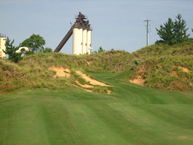 The third shot at the par-5 13th. Notice the top of the flagstick over the dune on the left.