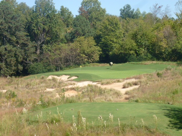 The par-3 6th, falling away left and right off a central crest, blends into the natural environment.