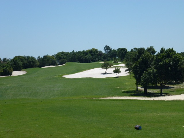 The gorgeous par-5 13th weaves through the sandscape toward a deep, notched green at the property's highest point.