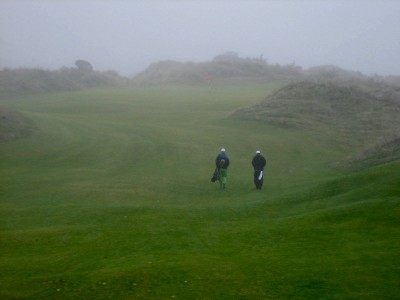 Into the gloaming: the walk into the first green at Bandon Trails, nestled between natural dunes.