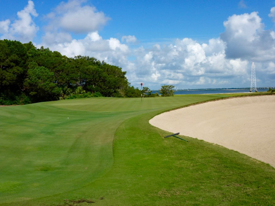 Perched slightly above grade, the par-4 11th green can be battered by winds sweeping across St. Simons Sound.