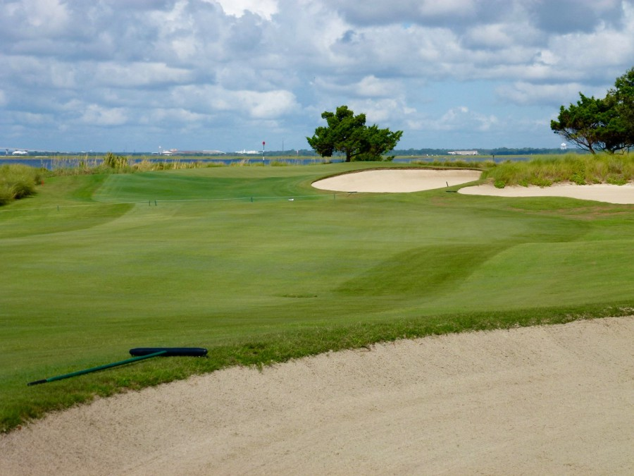 From the right side of the fairway, the 13th green, exposed atop a dune, is a more evasive target.
