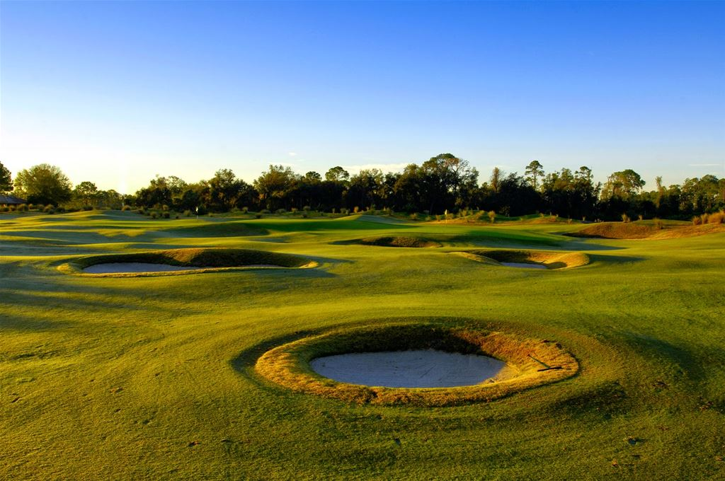 The second shot at the short par-5 6th (with the par-3 12 coming in at 9 o'clock) requires navigation through a minefield of pot bunkers. (photo: grandcypress.com)