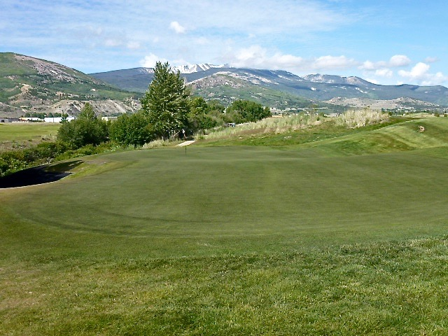 The three-tiered green at the par-5 11th, set on the far side of Warm Springs Creek, is the most highly contoured on the golf course.