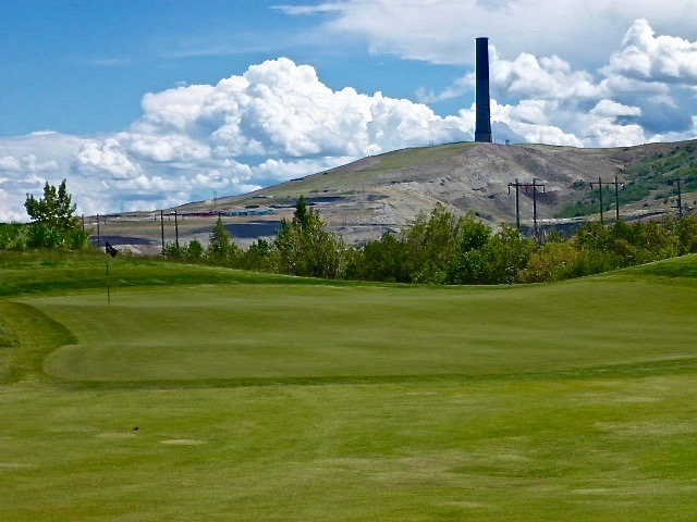 The entire Washington Monument can fit inside the old Washoe Smokestack seen here beyond the 9th green, the most intact remaining evidence of the heavy industry that once took place in Anaconda.