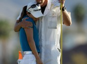 Caddie John Limanti tries to comfort I.K. Kim after her blown putt. (Getty Images)