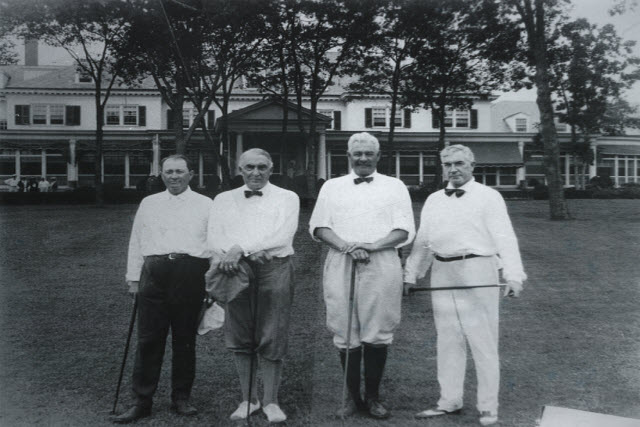 Geist, left, next to President Warren G. Harding, and two other guys
