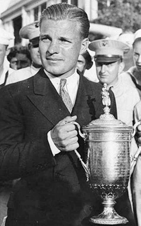 Johnny Goodman hoists the 1933 U.S. Open trophy. (George Pietzcker, USGA, USGA Museum, www.USGA.org)