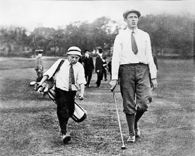 Francis Ouimet in 1913, with his diminutive caddie, Eddie Lowery