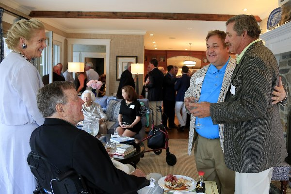 Ken Raynor (right) with Michael Patrick Shiels and President Bush at Kennebunkport