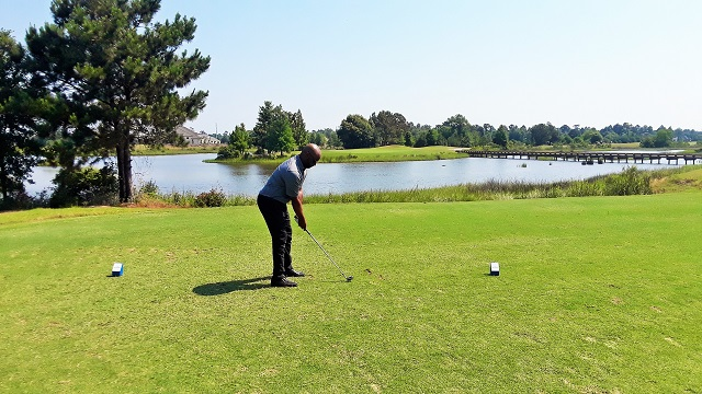 Pro Herb Piert tees it up at one of the two island greens at Gray Plantation