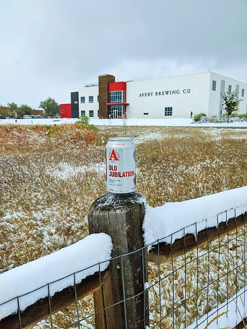 A beer outstanding in its field, showing the Avery brewery in the background.