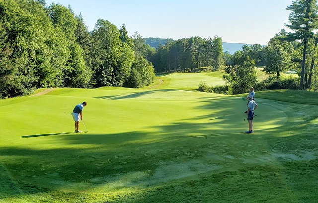 Final round players Jozefiak and Waite on the second green, Brattleboro Country Club.