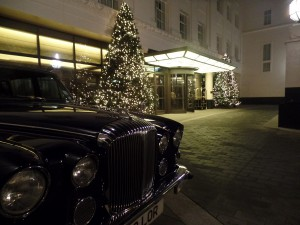 Royal romance: a ride past Buckingham Palace in the Queen Mother's vintage Daimler.