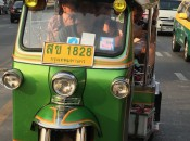 A Thai tuk-tuk takes tourists through the streets of Bangkok from the Anantara Siam Hotel.
