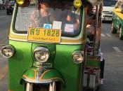 A Thai tuk-tuk takes tourists through the streets of Bangkok from the Anantara Siam Hotel.