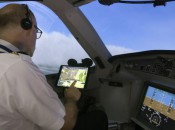 A Delta pilot uses Flight Weather Viewer turbulence app. (Photo Courtesy by Delta News Hub)