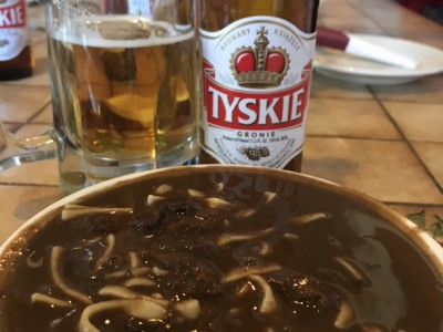 Czarnina, a Polish sweet-sour soup, washed down with a Tyskie beer.
