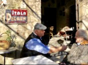 "Under the original ""Itala Pilsen"" sign, Michael Patrick Shiels sits with Lorenzo Motta at Bar Vitelli's."