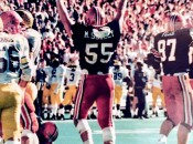 Mike Scully raising hands to celebrate during college game.