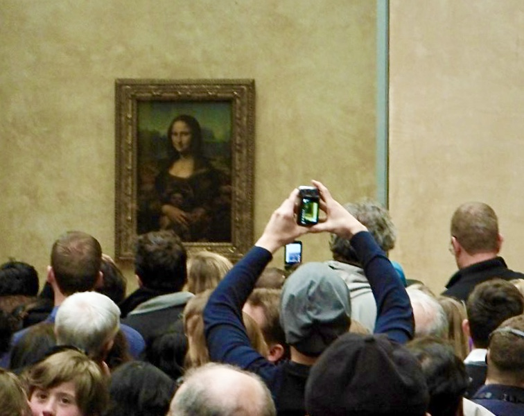 Mona Lisa smiles at the lines of casual art tourists corralled in the Louvre Photo by: Harrison Shiels