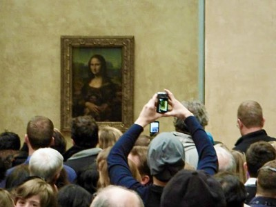 Mona Lisa smiles at the lines of casual art tourists corralled in the Louvre. (Photo by Harrison Shiels)