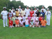 U.S. Navy Admiral Craig S. Faller surrounded by participating juniors and committee members during the MWGA Junior Golf Mentor Day, 2010.