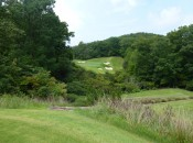The tee shot across a ravine at the par-3 11th is one of the best moments of the round.