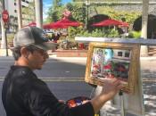 Street artist Lazaro Morera paints the scene at Clasico's intriguing corner. (Photo by Michael Patrick Shiels)