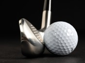 Putting the Tour Striker's sweet spot on the ball demands a classic downward swing with the shaft pointed toward the target.