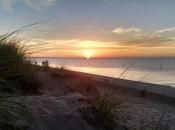 Lake Michigan sunset in Ludington.  Photo by Paul Bairley.