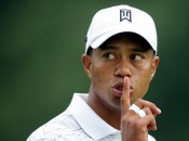 Tiger Woods of the United States gestures to a fan to be quiet from the fifth green during first round play at the WGC Bridgestone Invitational golf tournament in Akron